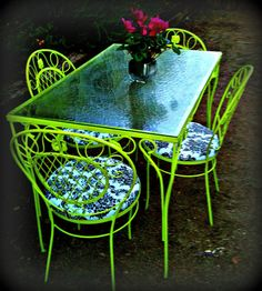 Restored table - lime green outdoor table and chairs. I need to find an old wrought iron set like this!! and paint hot pink w/ black & white pillows!!