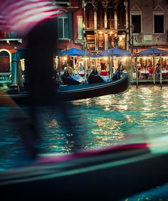 Honeymoon Activities: Exploring the canals of Venice, Italy at night.