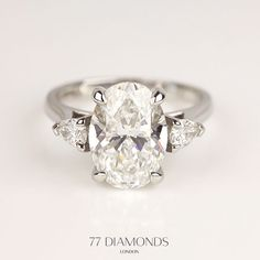 Looking for something extra special? This trilogy ring with a 3.25ct oval centre diamond and 2 pear shape diamonds as side stones was made by our bespoke team.