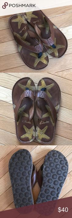 """Clarks Leather Flip Flops / Sandals women's Clarks leather flip flops with star pattern. Perfect beach flip flop!! In great sturdy condition and only worn a few times. A few tiny scratches in the sole leather but none on the thong portion of the flip flop. Size 8 - total length is 10.25"""". Clarks Shoes Sandals"""