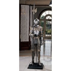 Our amazingly detailed, six-foot-tall, full-sized medieval suit on a museum mount is crafted from quality designer resin and finished in faux silver and brass. So realistic that it even features faux chain mail, faux leather strapping, and a hinged helmet that opens, it embodies the chivalry of the Renaissance and the ancient art of armour. Wielding a nearly seven-foot-tall halberd, this work of decorative art is fit for a king!