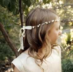 Cute little Ellie wearing a two strand pearl headband for her mom's special day.