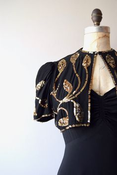 Amazing vintage 1930s black rayon crepe gown with sweetheart bodice, fitted waist, square back, metal side zipper and matching gold leaf beaded bolero. --- M E A S U R E M E N T S --- fits like: small/medium bust: 34-35 waist: up to 28.5 hip: free length: 61 brand/maker: Jeanne Barrie | New York condition: excellent ✩ layaway is available for this item To ensure a good fit, please read the sizing guide: http://www.etsy.com/shop/DearGolden/policy ✩ more v...