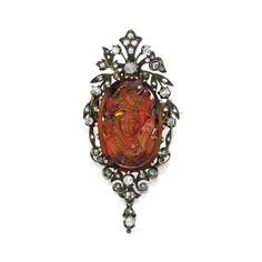 RENAISSANCE-REVIVAL CITRINE CAMEO AND DIAMOND BROOCH The oval-shaped cameo citrine en cuvette, featuring the bust of a woman in Renaissance costume, within scrollwork frames highlighted by numerous old European, old mine and rose-cut diamonds, one rose-cut diamond missing, last quarter of the 19th Century.