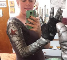 laheylupin: Winter soldier arm! I think I looked at every single tutorial and cosplay of this trying to decide how best to do it, but in the end just painting on skin-tight material seemed like the most comfortable and affordable option. (Also, I can paint pretty well but all of that foam molding and whatever else most people are doing seemed really intense). So! I tried to paint in trompe l'oeil contours and shading to really make the arm look like metal being affected by light (and also…