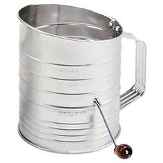 "Vintage-style flour sifter with three-cup measure.   Product: Flour sifterConstruction Material: Stainless steelColor: SilverDimensions: 6.25"" H x 6.75"" W x 5"" DCleaning and Care: Hand wash recommended"