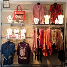 Let's think about ways to make your consignment, resale, or thrift wall rack array more enticing. Here's a good example...