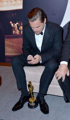 Leonardo DiCaprio Texting his model friends about the win. (Or tweeting about the environment.)