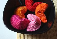 """Crochet fortune cookies: Use as a combo decoration/name tag on your gifts- put the """"to & from"""" inside the cookie"""