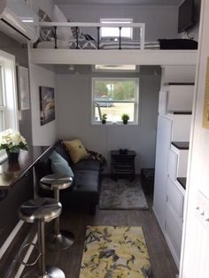 """8'6""""x 20' Tiny House, view past eating space to living room, storage stairs"""