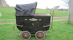 Vintage pram with canopy and art deco motifs