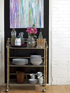 How to Style a Bar Cart by Jeanine Hays on @HGTV.  Image from Design Manifest.