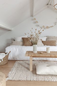 White Paint Colors: Rustic white living room with minimal farmhouse interior style and organic texture accessories | NONAGON.style #livingroomideas #livingroomdecor #whitedecor #farmhousedecor #scandinaviandesign #rustichomedecor