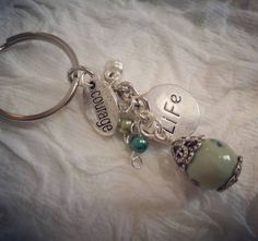 Check out this item in my Etsy shop https://www.etsy.com/listing/473230081/handmade-green-silver-keychain-courage