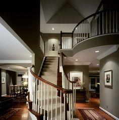Grey walls, wood floors, gorgeous stairs.