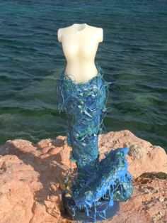 A body made of wax, a mermaid with a tail made of stone art, as a home decor.