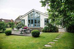 Light and airy extended bungalow. Jacqueline and Adrian Neville maximised the potential of their bungalow and created the perfect family space Bungalow Exterior, Bungalow Renovation, Bungalow Ideas, Backyard, Patio, House Extensions, Interior Photography, Open Plan Kitchen, My Dream Home