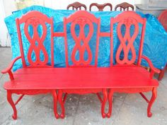 Red bench made from chairs