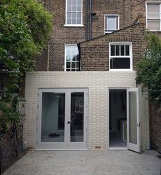Contemporary rear extension to Victorian terraced property using traditional materials.