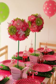 Topiary centrepieces featuring crystal daisies in hot pink, light pink and lime green with white butterflies