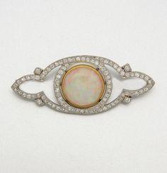 PLATINUM, OPAL AND DIAMOND BROOCH, CIRCA 1905 91 diamonds approx 1.00 ct.