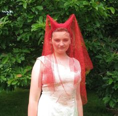 No wedding day is complete without a red horned veil