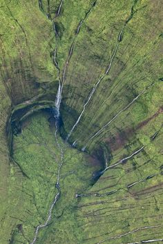Kauai's Mount Waialeale; generally considered the rainiest spot on the planet, drops much of its water down 3,000-foot walls so sheer, that there are only two days per year where the sun passes overhead.  Photo by Leona Boyd