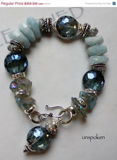 chunky charm bracelet, charm bracelet, statement bracelet, blue bracelet, aquamarine bracelet....Unspoken. $55.99, via Etsy.