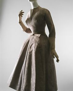 """La Cigale""  House of Dior  (French, founded 1947)  Designer: Christian Dior (French, Granville 1905–1957 Montecatini) Date: fall/winter 1952–53 Culture: French Medium: silk Dimensions: (a) Length at CB: 47 in. (119.4 cm) (b) Length: 44 in. (111.8 cm) Credit Line: Gift of Irene Stone, in memory of her daughter, Mrs. Ethel S. Greene, 1959"