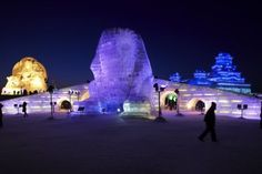 Workers shape snow sculptures prior to the Harbin International Ice and Snow Festival in Harbin, Heilongjiang Province December 18, 2009. The 26th Ice and Snow Festival will kick off on January 5, 2010, local media reported.