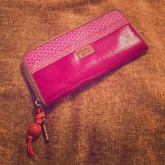 FOSSIL key-per pink zip wallet Pink wallet with orange accents. Lots of storage! 16 card slots with 1 plastic ID slot. Zip pocket for coins. 3 large pockets for cash, receipts or anything else you like to carry around! Excellent condition. Fossil Bags Wallets