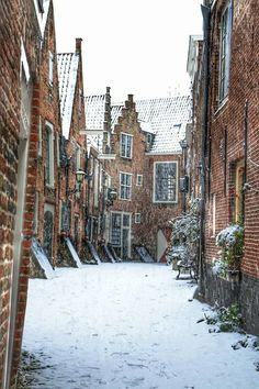 Snow against red brick