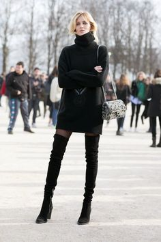 Anja Rubik in over-the-knee boots, in Paris.