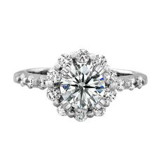 A total of 16 brilliant round white diamonds gracefully graduate on the 14k white gold shank and halo weighing 0.62 ctw. This classic diamond halo engagement ring is sure to remain a timeless jewelry piece. Natalie K design no. NK18960-W