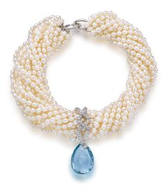 A cultured freshwater pearl, aquamarine and pearl necklace, Paloma Picasso for Tiffany & Co.  the fifteen strand torsade necklace composed of oval freshwater pearls measuring approximately 5.00 x 6.00mm., suspending a detachable diamond and aquamarine briolette pendant, and completed by a clasp of interlocking circles; signed Paloma Picasso, Tiffany & Co