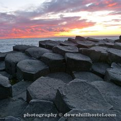Sunset at the Giant's Causeway County Antrim Northern Ireland by downhillhostel.com http://www.downhillhostel.com/wp-content/uploads/2012/07/giants_causeway_hostel_sunset_photography_10-copy.jpg