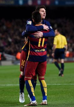 Barcelona's Brazilian forward Neymar (front) is congratulated by teammate Barcelona's Argentinian forward Lionel Messi after scoring during the Spanish league football match FC Barcelona vs Athletic Club Bilbao at the Camp Nou stadium in Barcelona on January 17, 2016.