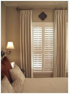 Beautiful wood  blinds complemented with neutral drapes. A functional and traditional window covering with a great look and appeal.