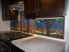 unbelievable mosaic back splash!    http://terrafirmastudios.com/installations/leffs-residence-kitchen/