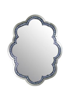 """Modrest Nebula Modern Wall Mirror. The Modrest Nebula modern wall mirror features a chic design with its intricate curvy frame accentuated with blue patterns that glisten in a semi-lighted room. Measuring W46"""" x D1"""" x H35"""", this modern wall mirror would make an excellent accent wall. Dimensions  W46"""" x D1"""" x H35""""  Color:  Other Finish:   Product ID(s):  17517"""