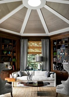 This study features so many chic details from the furniture to the grasscloth-covered vaulted ceiling.