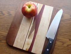 12 inch Maple and Black Walnut cutting board by SelectWoodcraft. More info here: https://www.etsy.com/listing/129967041/12-inch-maple-and-black-walnut-cutting