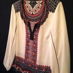 """Adrianna Papell cream navy, red and black 100% polyester. Very easy to wash and wear. No ironing if you take it out of the dryer right away. Very cute. It fits a 10/12 medium. Not sheer but you can wear a camisole.  I love this blouse but I'm just a little to big to wear right now. Too cute to be in my closet. I need to share. There is really nice piping down the sleeve. Full Length sleeve 24"""". Bust 41 and hip 42 and length is 25"""". Wear with any skinny pants. Adrianna Papell Tops Blouses"""