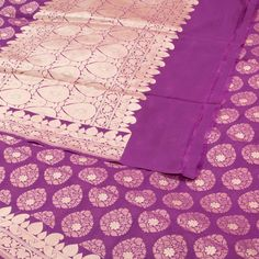 """The """"#Purple"""" #handwoven #Banarasi #Silk #Sari from Ghanshyam Sarode is woven with zari floral motifs all over the body that is set off by a floral motifs border on either side. Attractive paisleys, floral motifs in gold zari adorn the purple pallu. The border is repeated on the purple blouse that completes the sari."""