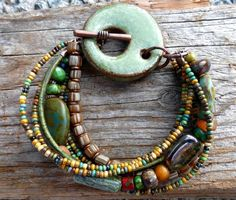 Green ceramic and Czech glass multi strand bracelet by McKee Jewelry Designs Clay Jewelry, Jewelry Crafts, Accessoires Hippie, Jewelry Design, Unique Jewelry, Sticks And Stones, Eye Art, Ibiza, Washer Necklace