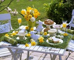 Cute yellow floral arrangement on spring garden party table Bunny Easter