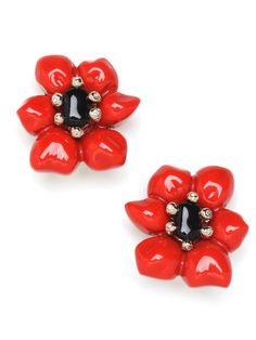 This is flower power with a sweet side. This pretty floral stud design, with red petals and silver filaments, comes with a glossy finish that resembles a candied marzipan treat.