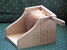 A perfect companion accessory for a freshly made loaf of bread is a homemade bread slicer. The use of a bread slicing guide can be used to make one at home.