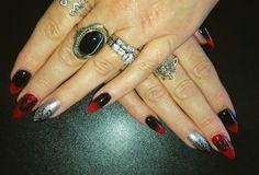 Black widow stiletto nails
