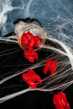 Drunken Gummy Spiders. Recipe for vodka gummy candy that looks like spiders. A fun adult Halloween treat that is easy to make and requires only 3 ingredients.These are similar to vodka gummy bears but require no soaking. #ElleTalk #Cocktails #halloween #vodka #candy